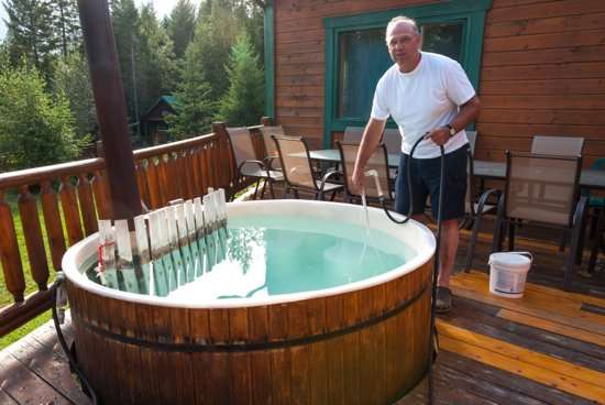Rob Patenaude prepares the hot tub.